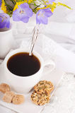 A cup of coffee with pastry and  blue bluebell Royalty Free Stock Photography