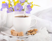 A cup of coffee with pastry and  blue bluebell Stock Image