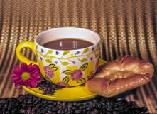 Cup of coffee with pastry Stock Photos