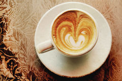 Cup of coffee. On pattern textured paper Royalty Free Stock Image