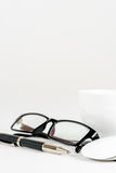 Cup of coffee, pen, mouse and glasses, on a background Stock Image