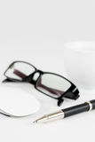 Cup of coffee, pen, mouse and glasses, on a background Stock Images