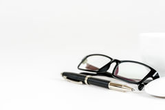 Cup of coffee, pen, mouse and glasses, on a background Royalty Free Stock Photography