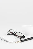 Cup of coffee, pen, mouse and glasses, on a background Stock Photo