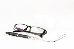 Cup of coffee, pen, mouse and glasses, on a background Stock Photography