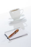 Cup of coffee, pen and notebook Stock Photography