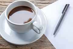 Cup of coffee, pen and paper Royalty Free Stock Photography