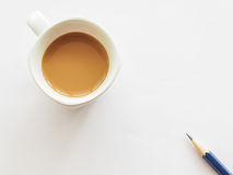 Cup of coffee with pencil Stock Photography