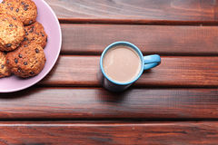 Cup of coffee and the phone on the table Royalty Free Stock Photos