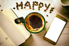 Cup of coffee and phone Royalty Free Stock Photo