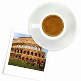 Cup of coffee and a photo of colloseum Royalty Free Stock Photos