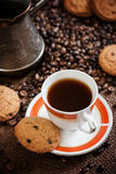 Cup of coffee. Photo of a cup of coffee with cookies stock photography