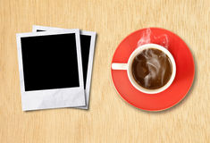 Cup coffee and photo frame Stock Photos