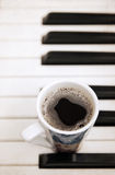 Cup of coffee, piano Royalty Free Stock Image