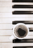 Cup of coffee, piano Royalty Free Stock Photography