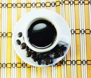 Cup of coffee. On a piece of bamboo Stock Photo