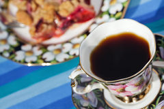 Cup of coffee and a piece of cake Royalty Free Stock Images