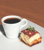 Cup of coffee and piece of cake Royalty Free Stock Image