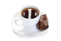 Cup of coffee with  a piece of chocolate Stock Image
