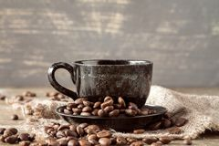 Cup of coffee on piece of sackcloth Stock Photography