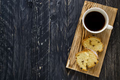 Cup of coffee and pieces cake on wooden bred Royalty Free Stock Images