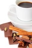 Cup of coffee, pieces of chocolate and spices Royalty Free Stock Photography