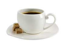 A cup of coffee with pieces of sugar Stock Image