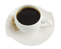 A cup of coffee with pieces of sugar Stock Images