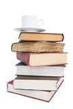 Cup of coffee on a pile of books. Cup of coffee and pile of books on a white backgruond Royalty Free Stock Photo