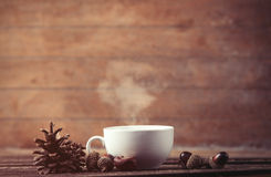 Cup of coffee and pine cone with acorns Royalty Free Stock Photo