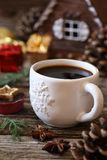 Cup of coffee, pine cones and Christmas-tree decorations Stock Image