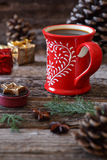 Cup of coffee, pine cones and Christmas-tree decorations Stock Photography