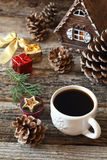 Cup of coffee, pine cones and Christmas-tree decorations Royalty Free Stock Image