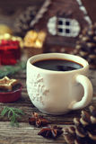 Cup of coffee, pine cones and Christmas-tree decorations Royalty Free Stock Photos