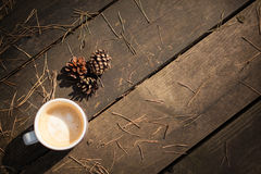 Cup of coffee and pine cones Royalty Free Stock Image