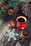Cup of coffee, pine cones and New-Year tree decorations Royalty Free Stock Image