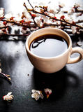 Cup of coffee and pink cherry blossoms. flowers stock photos