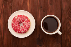 Cup of coffee and pink donut Royalty Free Stock Image