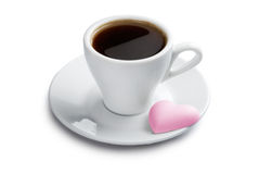 Cup of coffee with pink heart shape cookie Royalty Free Stock Photos