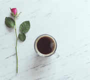 Cup of coffee and a pink rose on marble background Stock Photography