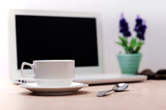 Cup of coffee place in front of Laptop. And a vase of lavender flower,for business concept Stock Photos