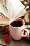 Cup of coffee with plaid and book on the grey wooden background Royalty Free Stock Image