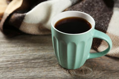 Cup of coffee with plaid on a grey wooden background Stock Photo