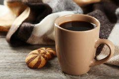 Cup of coffee with plaid on the grey wooden background Stock Photo
