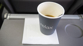 A cup of coffee on the plane Stock Photos