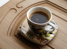Cup of coffee on the plank royalty free stock photo