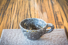 Cup of coffee on plate. Cup of coffee on ceramic plate Stock Photos
