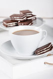 Cup of coffee and plate with cookies on a white tray Stock Photography