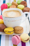 Cup of coffee and plate of  macaroons Stock Images