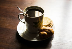 Cup of coffee on a plate in soviet style Stock Images